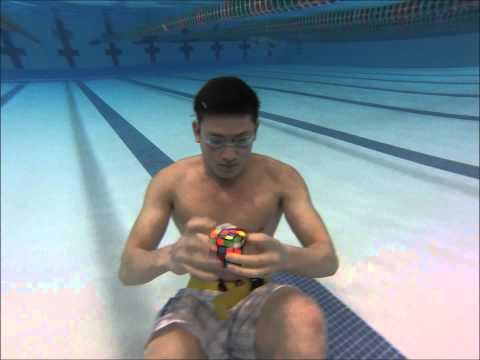 Dude Solves 3 Rubik's cubes Underwater in 1 minute!