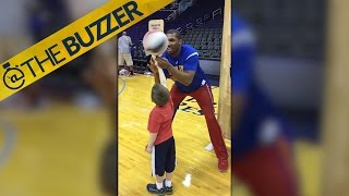 Globetrotter and young fan celebrate after completing a trick together by @The Buzzer