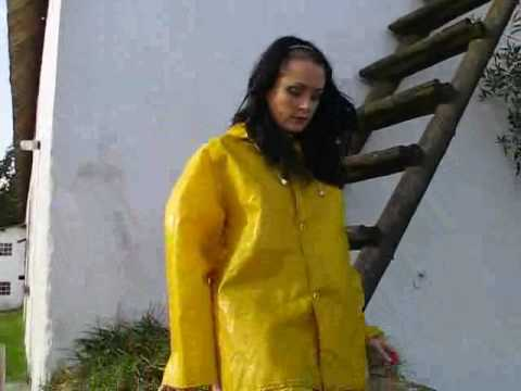 Rainweargirl - Walking on farm in yellow PVC rainsuit.