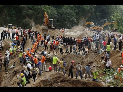 Families mourn victims of Guatemala landslide, hundreds feared dead