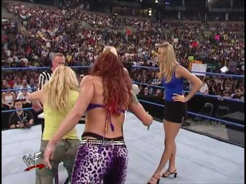 Trish Stratus With Lita vs Torrie Wilson With Stacy Keibler In An Arm Wrestling Match