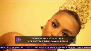 Agnes Monica di Video Klip 'Coke Bottle' Mengenakan Kebaya