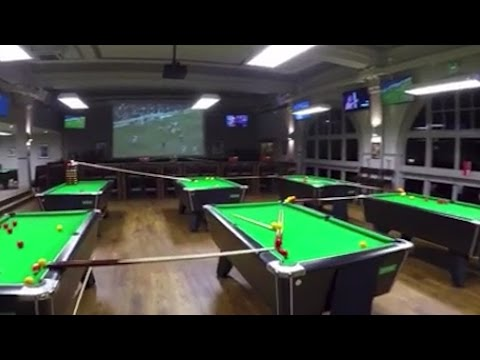 The World's Greatest Billiards Shot Spanned Two Floors And Nine Pool Tables