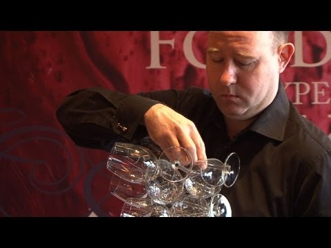 one for one glasses - Beijing-based sommelier Philip Osenton breaks the world record for the number of wine glasses held in one hand. The previous world record was 39, set in Spai...