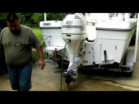 how to unclog outboard motor