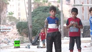 Под прицелом террористов: сирийцы рассказали RT о жизни на линии фронта в Алеппо