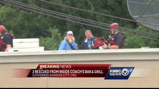 Kansas City firefighters rescued two people Thursday trapped by flooding at a south side bar & grill.Subscribe to KMBC on YouTube now for more: http://bit.ly/1fXGVrhGet more Kansas City news: http://kmbc.comLike us:http://facebook.com/kmbc9Follow us: http://twitter.com/kmbcGoogle+: http://plus.google.com/+KMBC