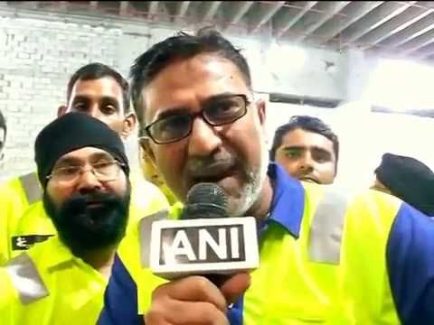 Workers at the camp after meeting PM Modi in Qatar