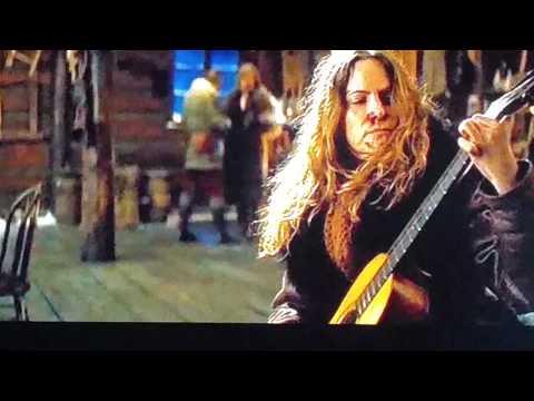 Watch Kurt Russell Blow Up An 1870's-Vintage Martin Guitar!