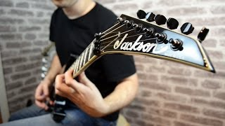 Series: USA Select SeriesYear of manufacture: 2003Body: AlderNeck: Neck-Thru-Body Quartersawn MapleNeck Dimensions: 3rd Fret: .790 inch, 12th Fret: .850 inchTuning Machines: Die-Cast TunersFingerboard: EbonyNumber of Frets: 24 Jumbo FretsBridge Pickup: EMG 81Neck Pickup: EMG 85Controls: Master Volume, Master ToneBridge: Floyd Rose Original Double Locking 2-Point TremoloPickup Switching: 3-Position Toggle: Position 1. Bridge Pickup, Position 2. Bridge and Neck Pickups, Position 3. Neck PickupHardware: BlackCase: Original Hard CaseScale Length: 25.5 inchesSpecial thanks to Udo for letting me try his Jacksons!