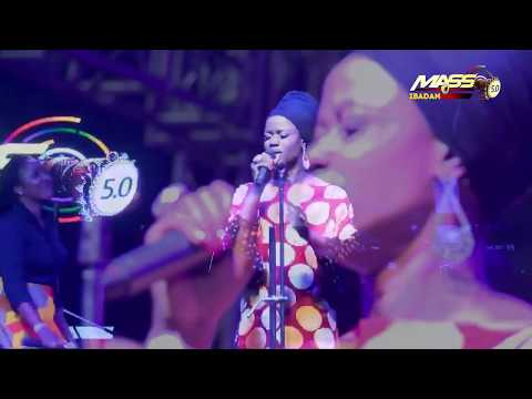 Sola Allyson leads worshippers in the rain at MASS 5.0 Concert Tour of Ibadan