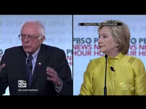 Clinton, Sanders Clash Over Wall Street, Obama