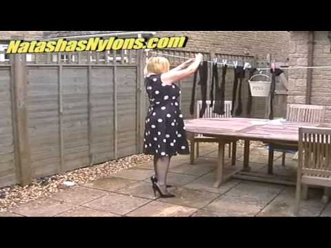 Housewife In Blue Tights Hangs Out Her Stockings and Pantyhose On The Washing Line