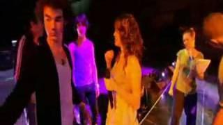 Miley Cyrus pushes Joe Jonas to hug Nick Jonas