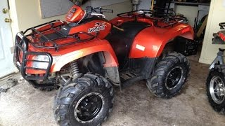 9. Arctic Cat 700 ATV Plowing Snow in Minnesota