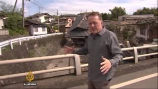 Japan aftershock hits during Al Jazeera live report