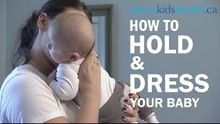 How to hold and dress your newborn baby