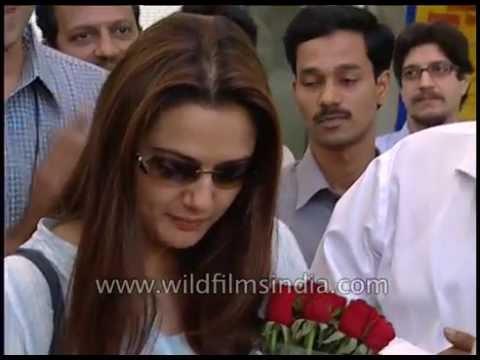 Preity Zinta's dimpled laugh - signs autographs at Reliance Info launch, Karan Johar hangs around