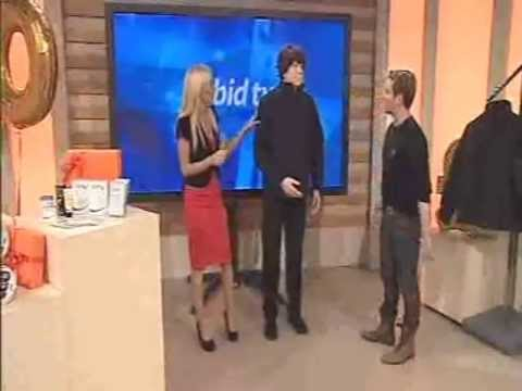 mannequin-man performming as a Living Mannequin: Carmel Thomas and guest presenter Andrew Stone encounter a mannequin that moves while selling a coat on bid-tv for bid-tv on 12/10/2010