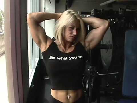 Big Blonde Muscle Woman posing and flexing her powerful muscles