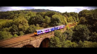 Drone video capturing a Viaduct built 1865. The Viaduct passes over the Goyt River in Strines. This features a trainline running ...