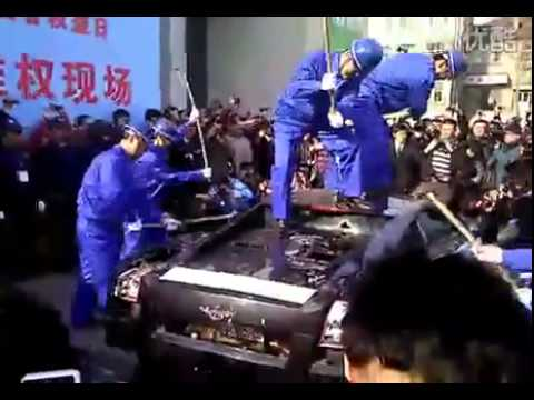 Chinese Entrepreneur Destroys $750,000 Car with Sledgehammers picture