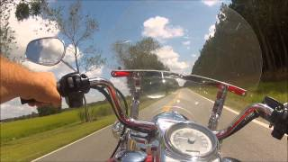 9. 2012 Road King stock mufflers