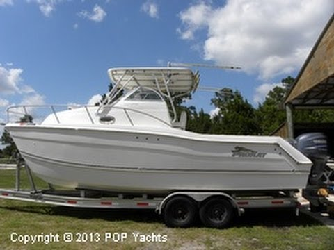 2660 - Make sure to check out all of our inventory at http://popyachts.com Insane cockpit and helm area with live well and gear very close. Owners say she's a dream...