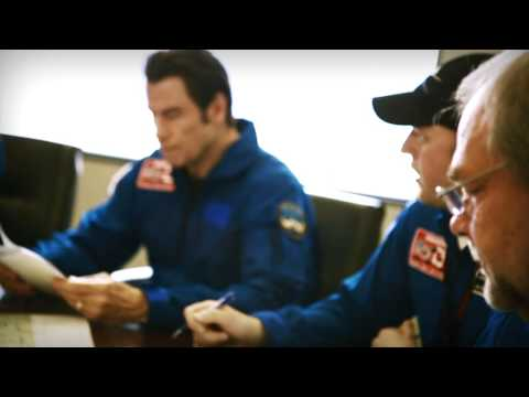 John Travolta - John Travolta, Challenger ambassador, experiences the Challenger 350 aircraft and flies on one of its test flights at Bombardier's facilities in Dallas, Tx a...