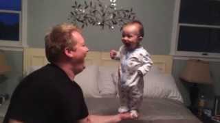 Baby Balancing On Dad's Hand