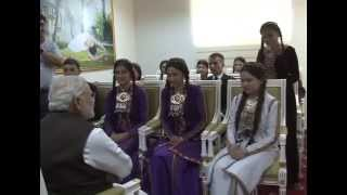 The Prime Minister, Shri Narendra Modi interacting with the students of Hindi after the inauguration of the Traditional Medicine and Yoga Centre, in Ashgabat, ...