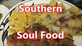 Grilled pork chops w soul food sides featuring a Kuma Chef's Knife by Louisiana Cajun Recipes