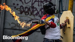 Venezuela has more oil than anywhere on Earth, and yet it can't provide basic food and services to its citizens. Bloomberg QuickTake examines how Venezuela's poor economy and increasingly authoritarian leader have made it into Latin America's powder keg. Video by Henry Baker