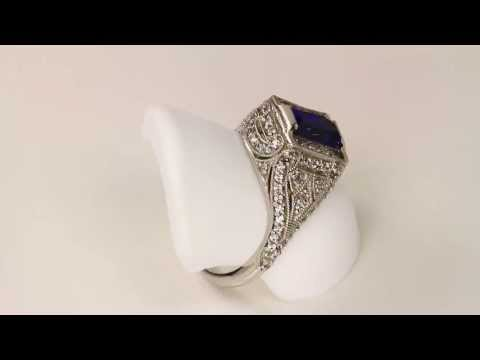 Antique Highly Detailed Ring with Emerald Cut Tanzanite