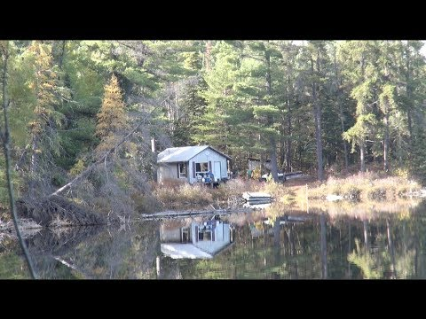 Cabin - On this trip i travel to my remote cabin in the wilderness by atv. We head out and fish lakes rivers and do some hunting. Hope you enjoy the video.