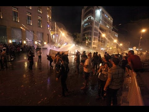 Lebanese security forces fire water canon and tear gas to break up an anti-government protest in Beirut on Thursday.