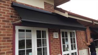 Drop Arm Fabric Awning with Sign Writing Ballina