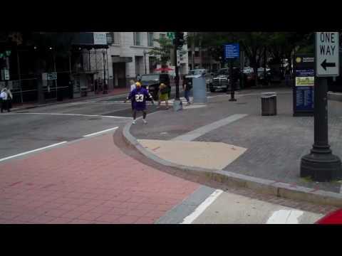 Man dancing on street corner in D.C.