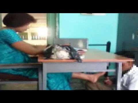 Caught on camera: school teacher makes student massage her feet