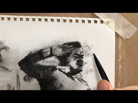 Drawing a small face in charcoal