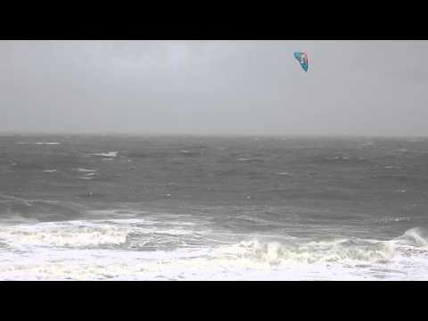 Wind surfer takes Hurricane Sandy's storm-tossed waves for a wild ride in Ocean City, MD