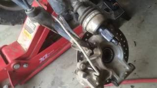 5. HOW TO REMOVE THE REAR AXLE Polaris Sportsman 850 XP