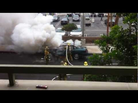 Firefighter Battles Exploding Car