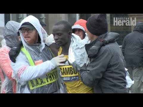 Boston Marathoners battle bone chilling cold with immense heart in 122nd race