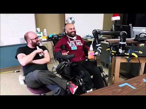 Paralyzed man drinks beer using mind-controlled arm
