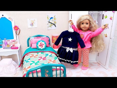 Doll playing with dress up and makeup toys