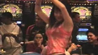A Chinese Girl Dances Like Crazy In A Casino