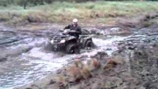 6. 2010 CanAm Outlander 800 XTP in a creek