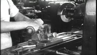Group of men and women work at Browning Automatic Rifle  factory in the United St...HD Stock Footage