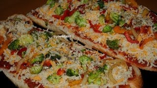 It's snowing like crazy here- about 10 inches! So, after all the shoveling, I wanted to make an easy dinner, so I made an easy version of homemade pizza, and named my invention LazyDay Pizza! I made a vegetarian version, but you can add your favorite meat. Bon appetit!